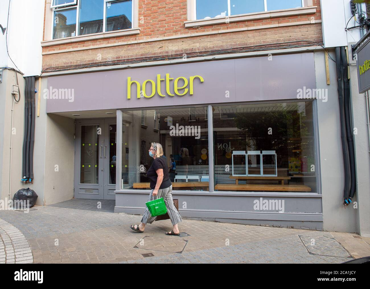 Windsor, Berkshire, UK. 3rd August, 2020. Hotter Shoes are going ahead with a Compulsory Voluntary Arrangement (CVA) which will mean the closure of 46 of their stores. All shoes on sale in the Windsor store have been removed so it may be one of the store closure casualties. Credit: Maureen McLean/Alamy Live News Stock Photo