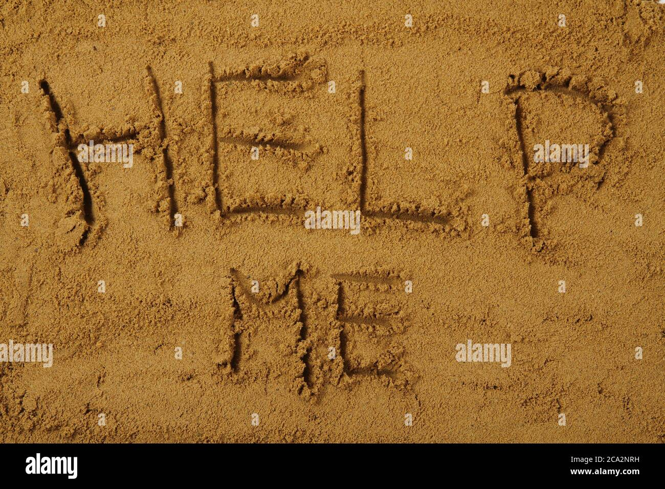 help me in the sand as summer background Stock Photo - Alamy