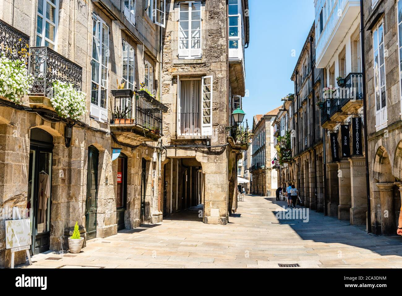 Santiago de Compostela, Spain - July 18, 2020: Old street with arcades in medieval town Stock Photo