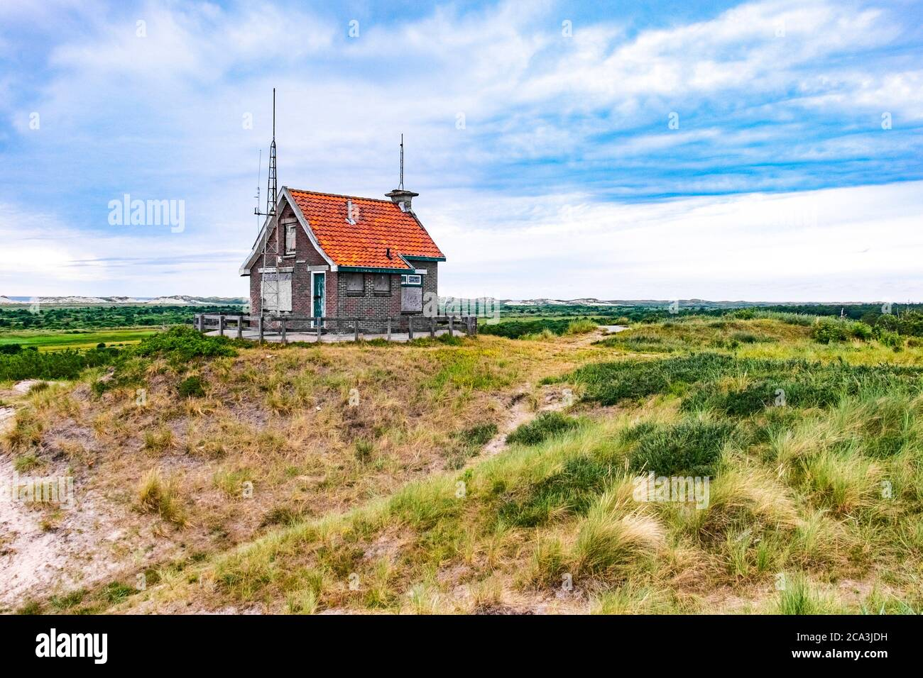 Little uninhabited house on the hills with view on the wadden sea on Frisian Island Terschelling, The Netherlands, Europe. Stock Photo