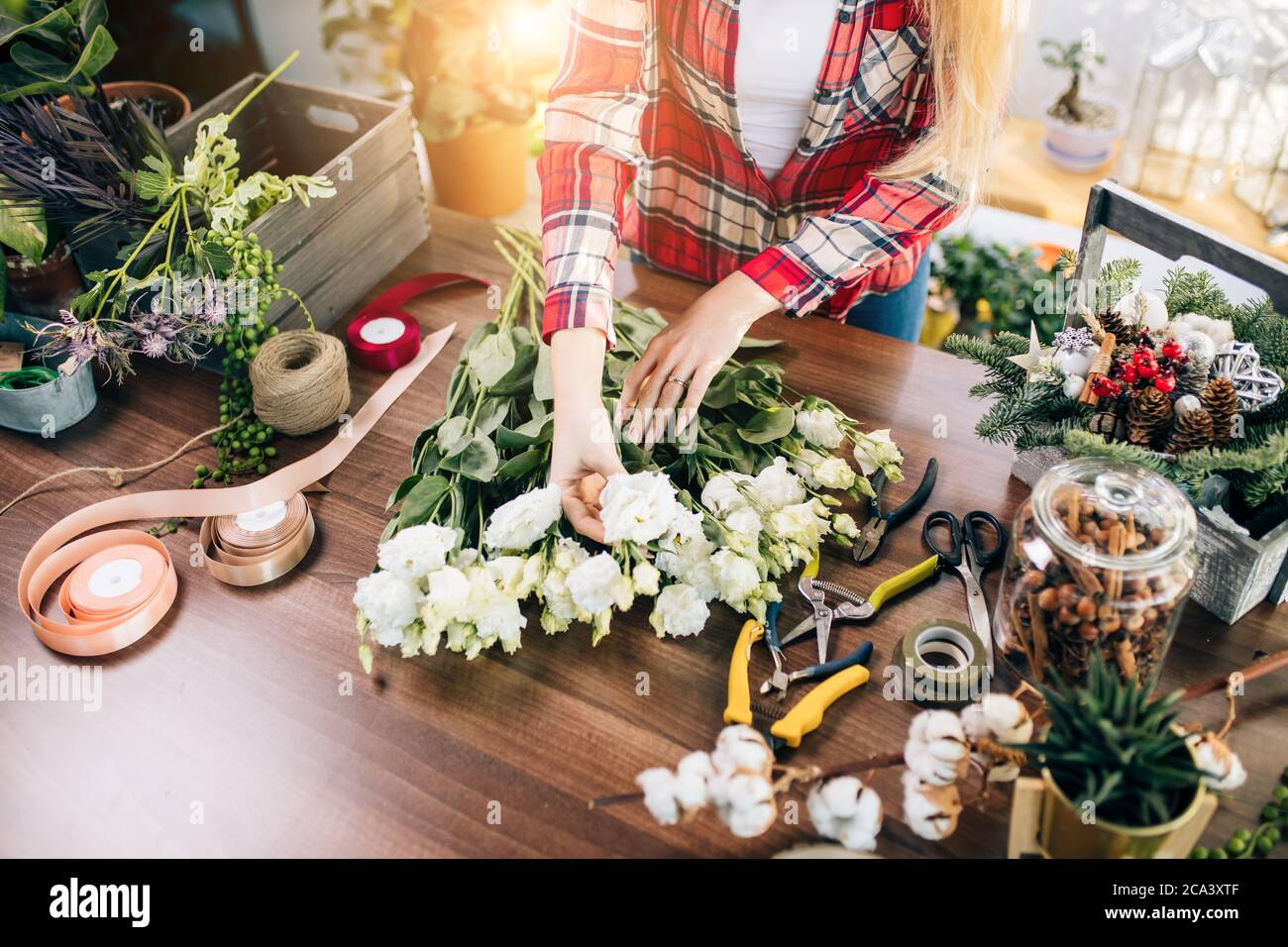 flowers composition by young and attractive florist woman, decoration and gardening concept. bouquet of fresh beautiful flowers Stock Photo