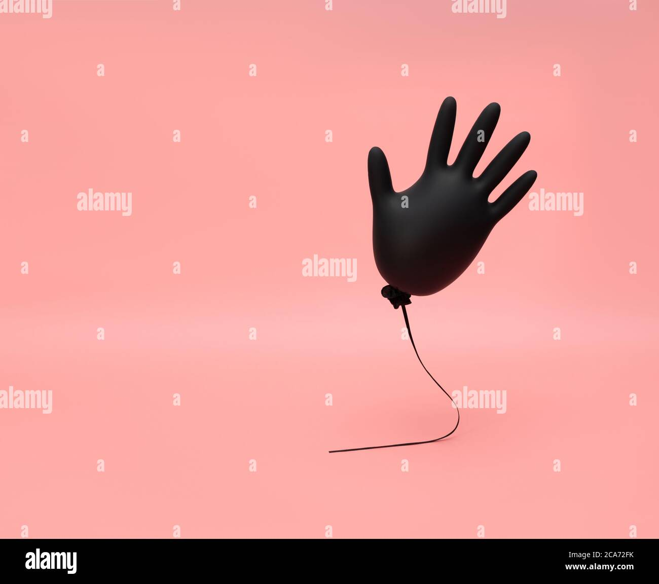 Black inflated flying rubber glove on a pink background. Prevention and protection against coronavirus, covid-19. Minimal medicine concept. Copy space Stock Photo