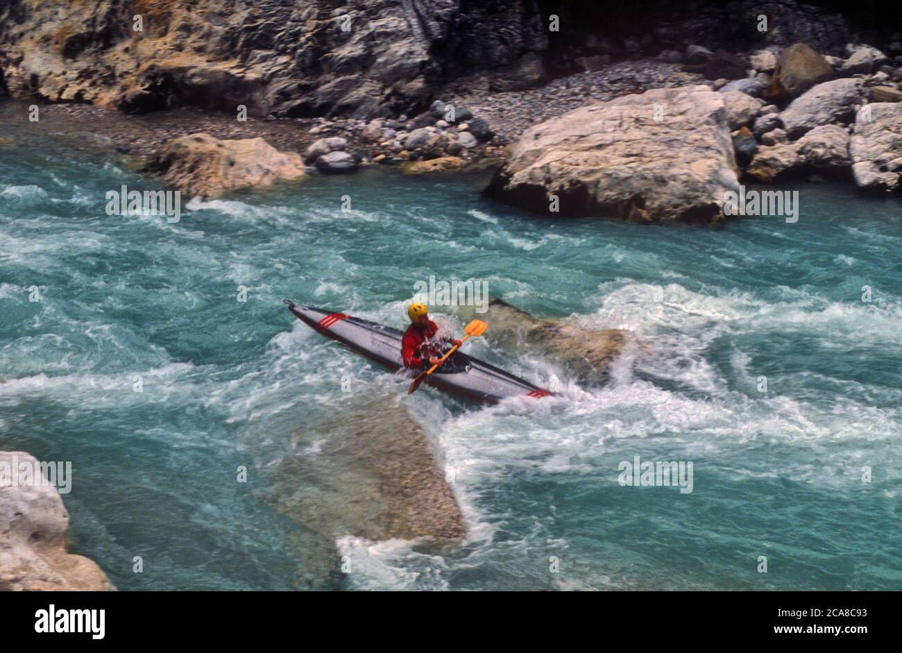 By canoe on the Cellina torrent. Stock Photo