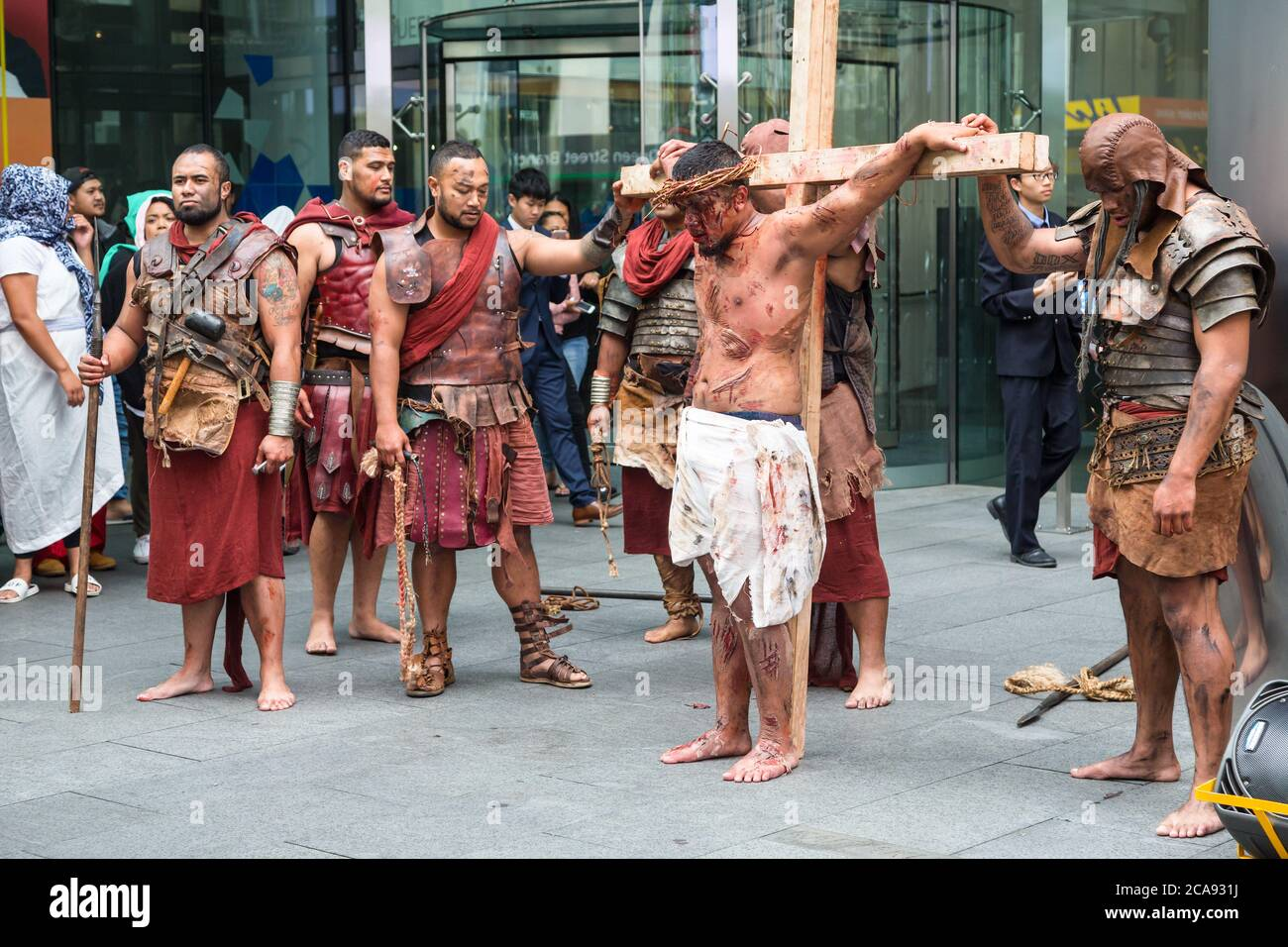 A reenactment of the crucifixion carried out by members of a Polynesian church dressed as Jesus and Roman soldiers. Auckland, New Zealand, 3/31/2018 Stock Photo
