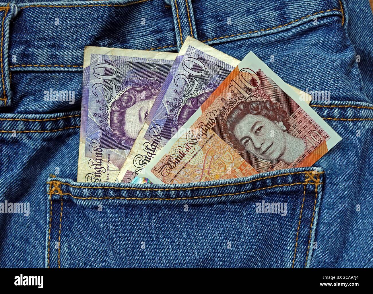 Money in your back pocket, black economy,cash in hand jobs,gig economy, cash in hand work,Report a business or your employer to HMRC Stock Photo