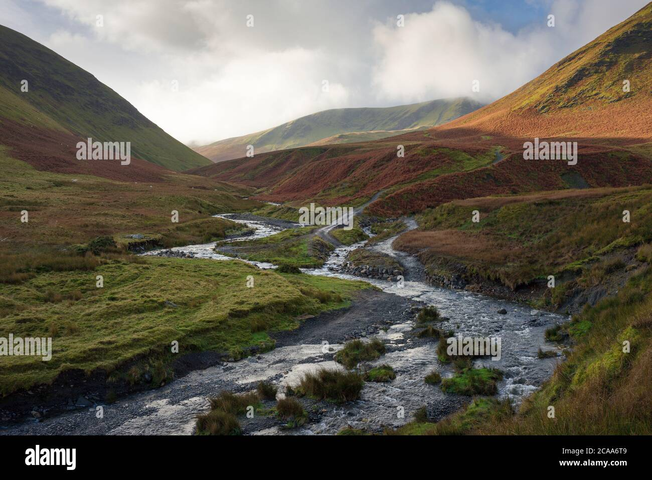 The confluence of the River Glenderamackin and Bullfell Beck with Bannderdale Crags beyond in the Lake District National Park, Cumbria, England. Stock Photo