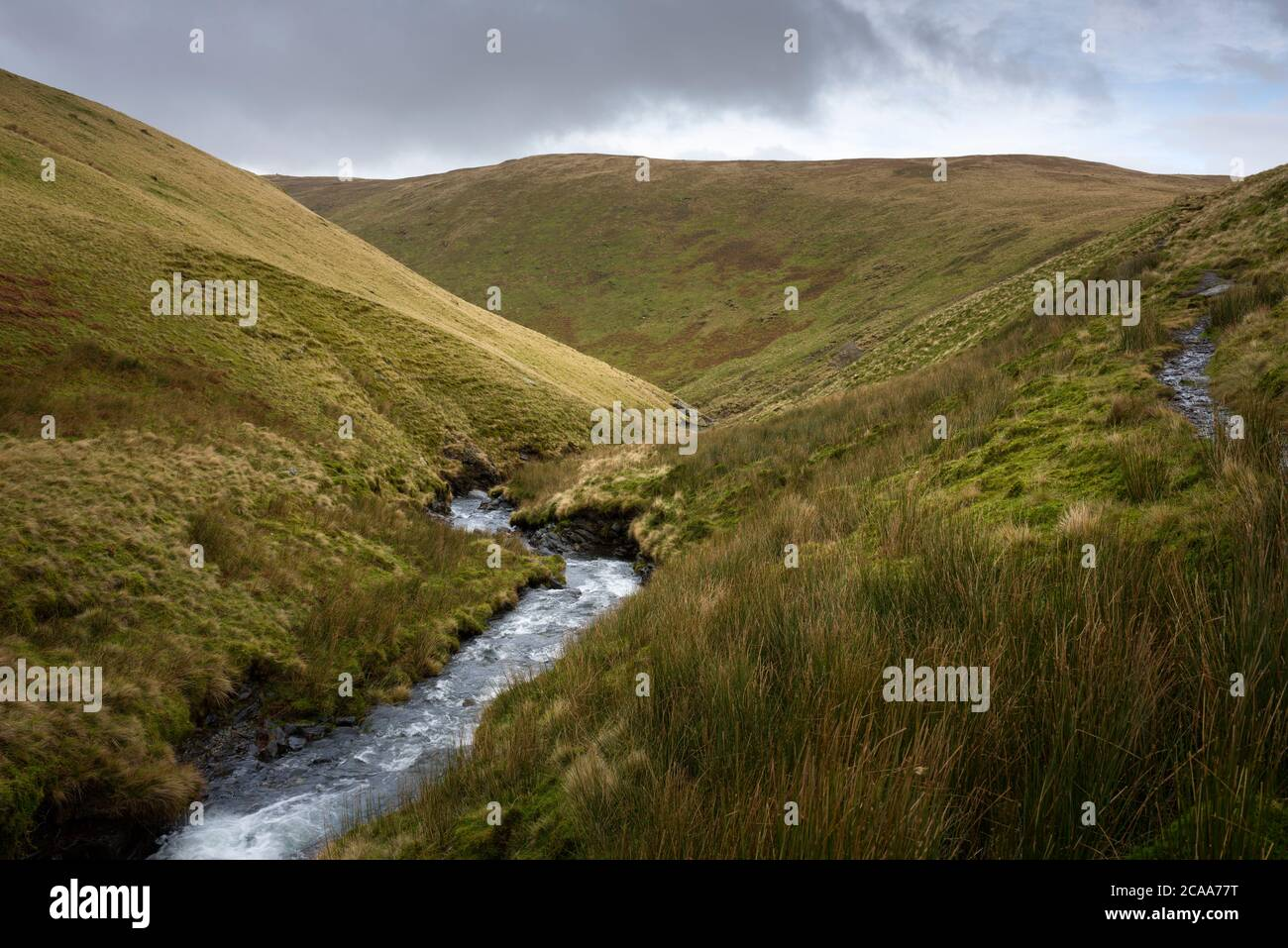 River Glenderamackin in the valley between Bannderdale Crags and Scales Fell with Southern Fell beyond in the Lake District National Park, Cumbria, England. Stock Photo