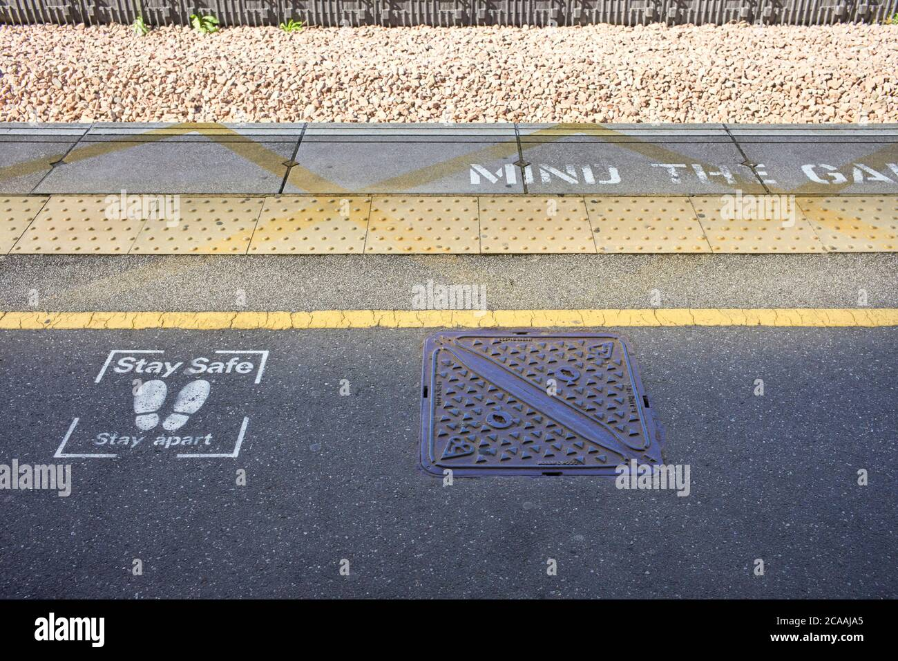 Stay safe, stay apart sprayed on messages at Milton Keynes, railway station Stock Photo