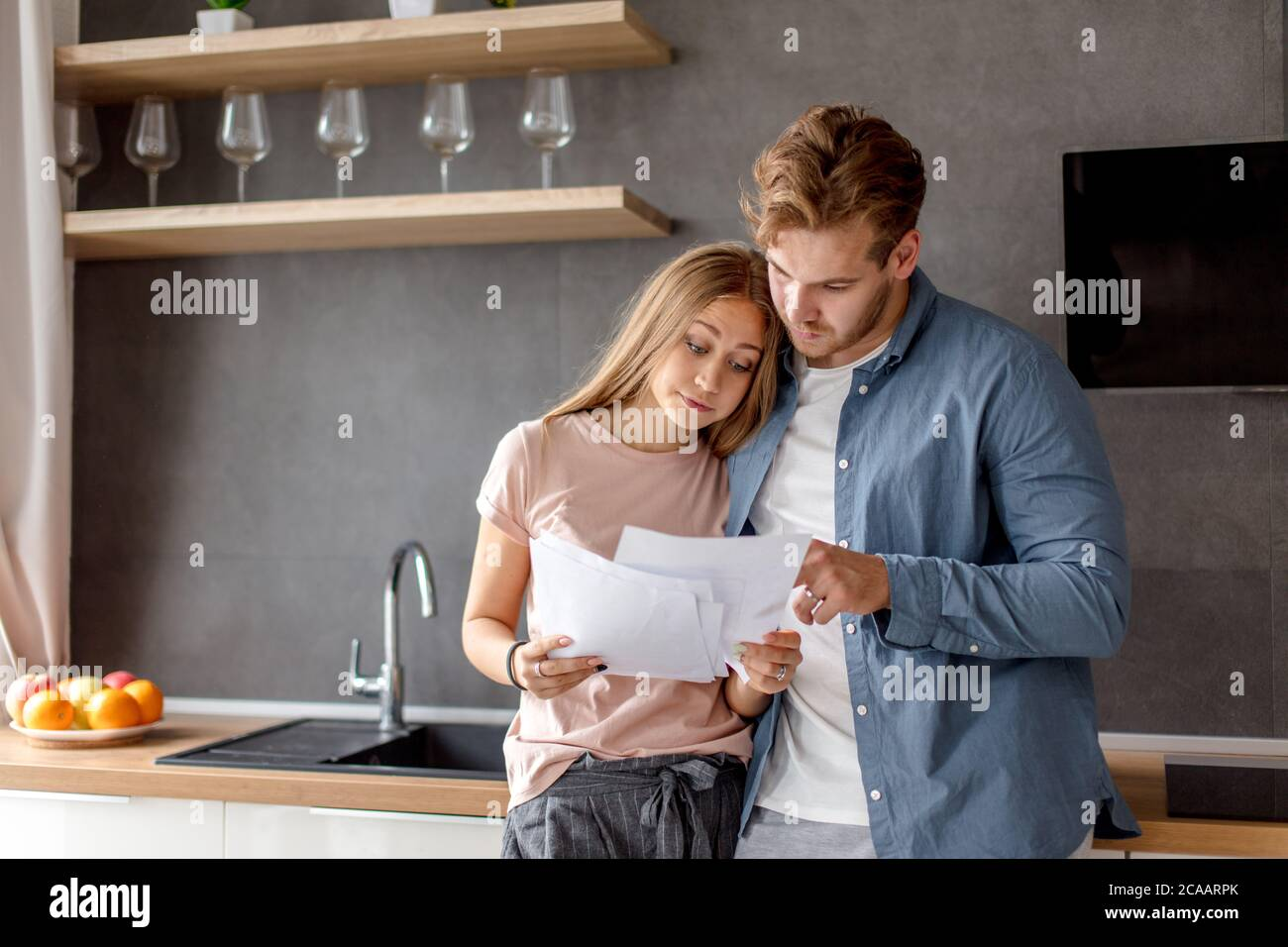surprised unhappy couple has informed about debt. young people have problems with bank. close up photo Stock Photo