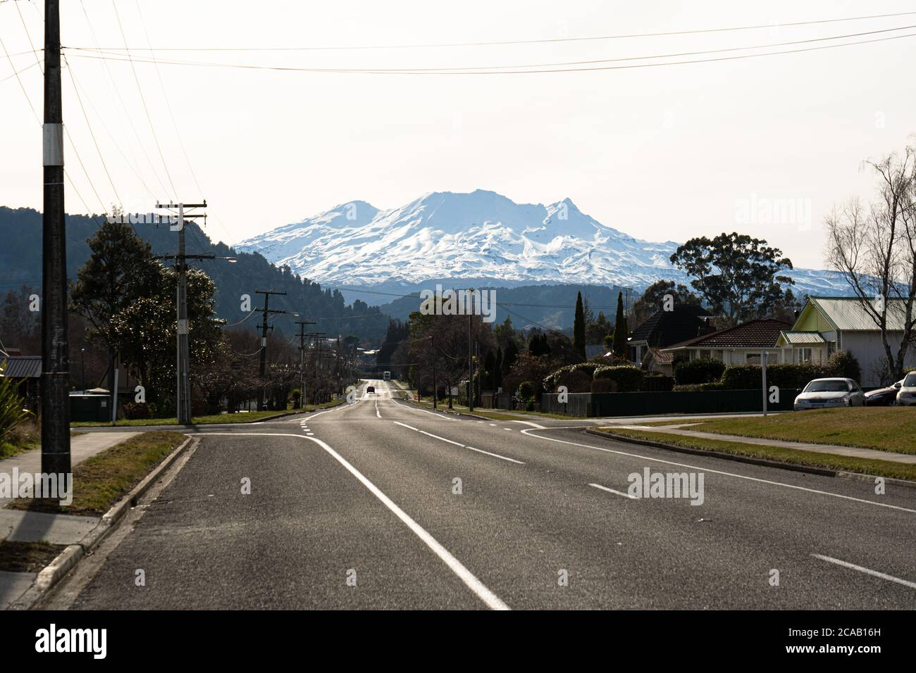 Empty street in Ohakune, New Zealand in winter, with Mt Ruapehu and the Turoa ski field in the background. Stock Photo