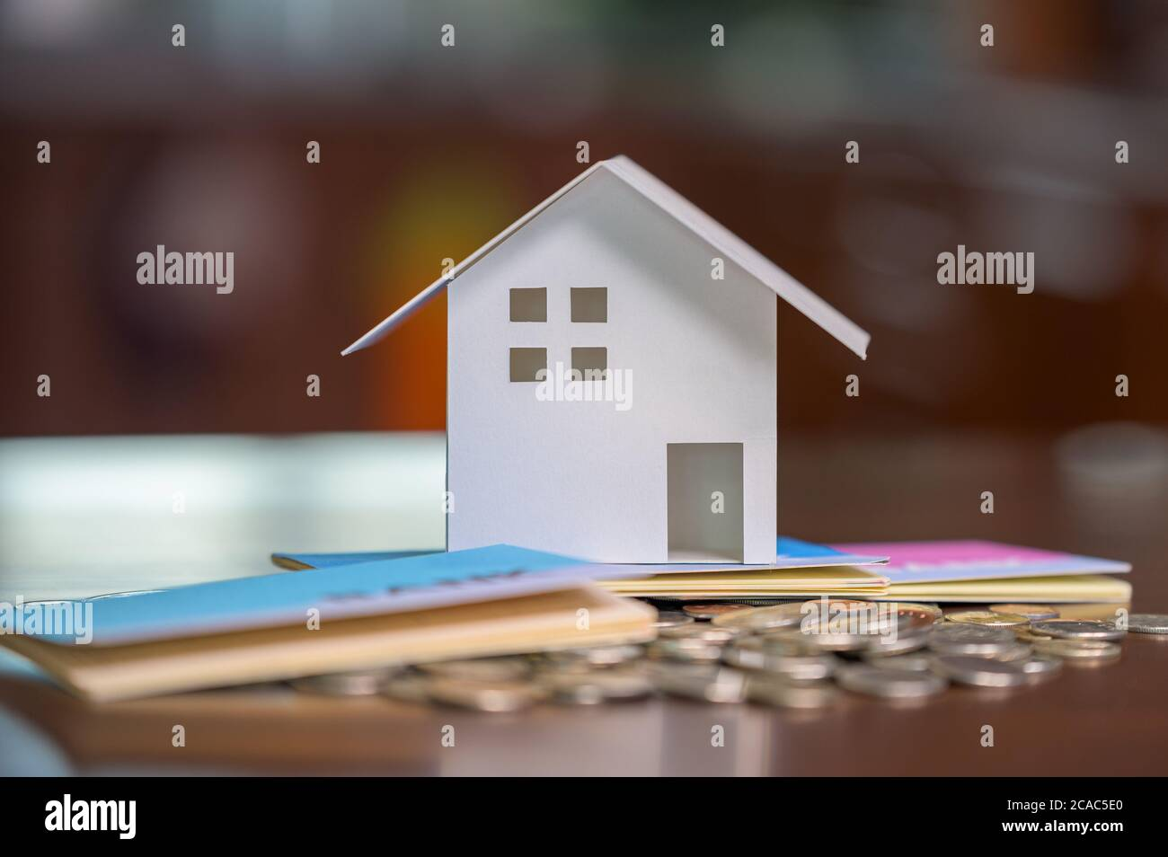 Model houses and stacked coins. Home equity loans. Mortgages and loans. Stock Photo