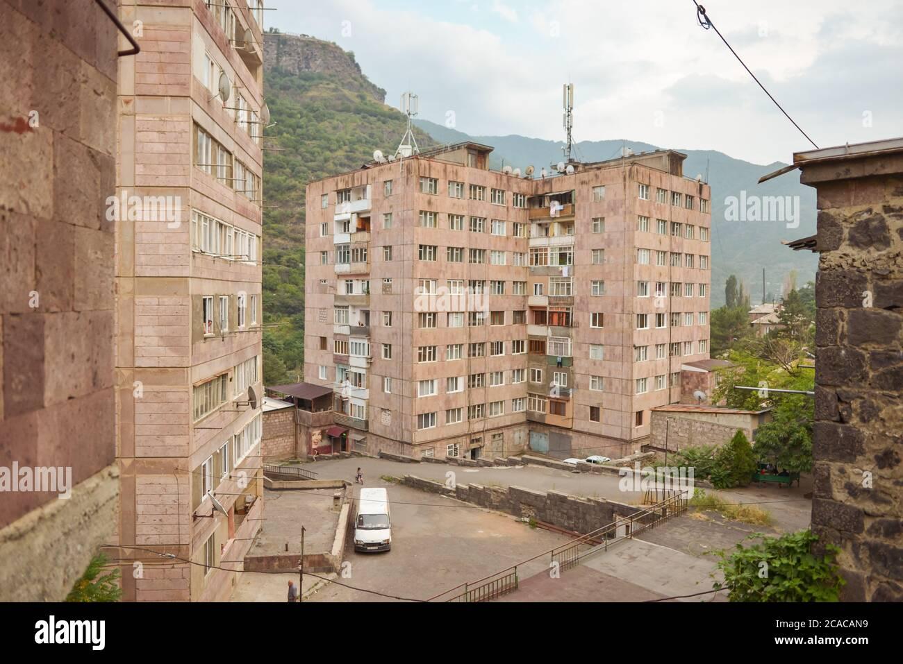 Alaverdi / Armenia - July 20, 2019: Soviet style buildings and vehicles from the streets of Alaverdi Stock Photo