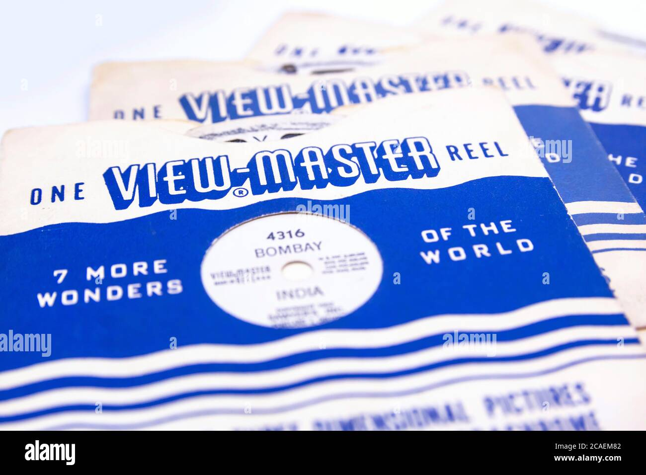 View Master, retro 3D photo viewer and it's reel on white background. Stock Photo