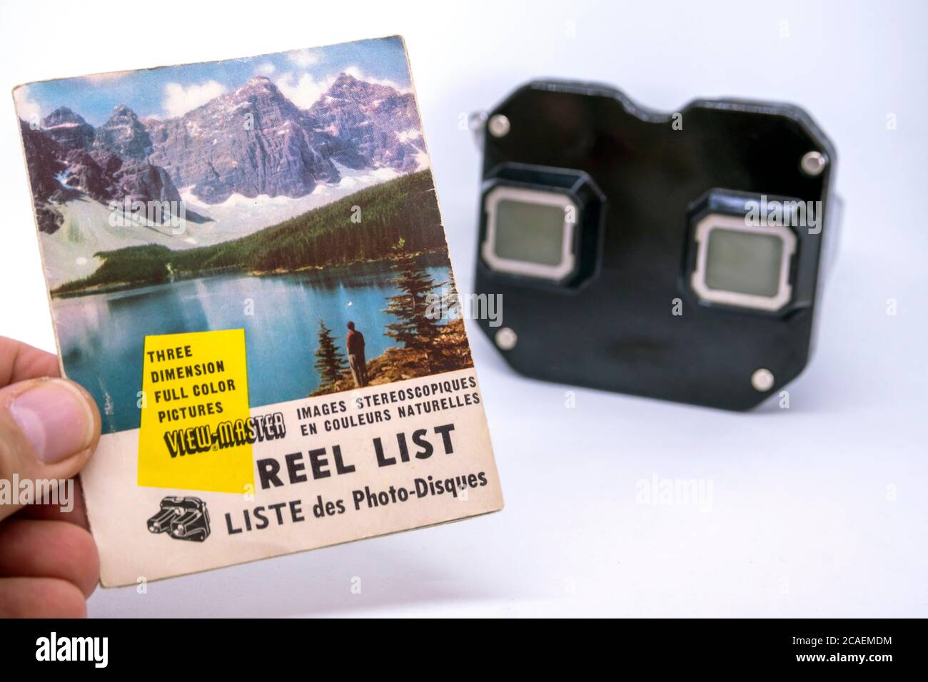 View Master, retro 3D photo viewer and it's brochure on white background. Stock Photo