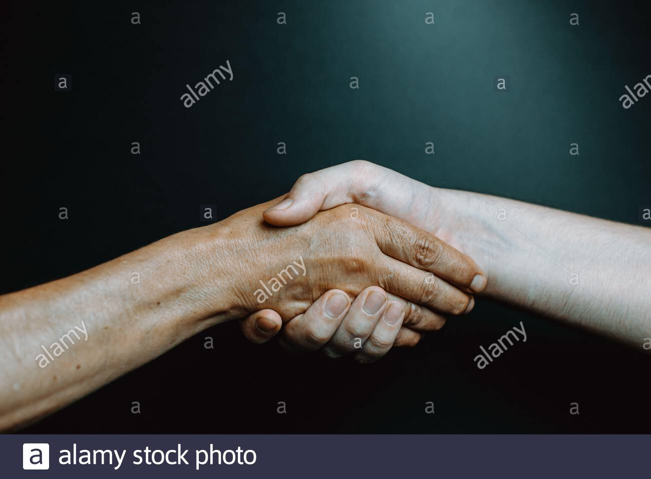 Old latina woman and young boy hand shaking hands Stock Photo