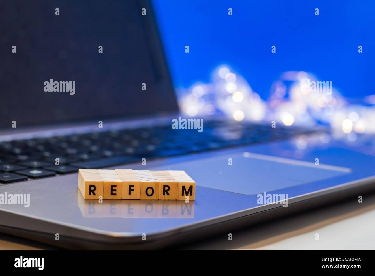 REFORM  letter blocks business finance concept on laptop keyboard Stock Photo