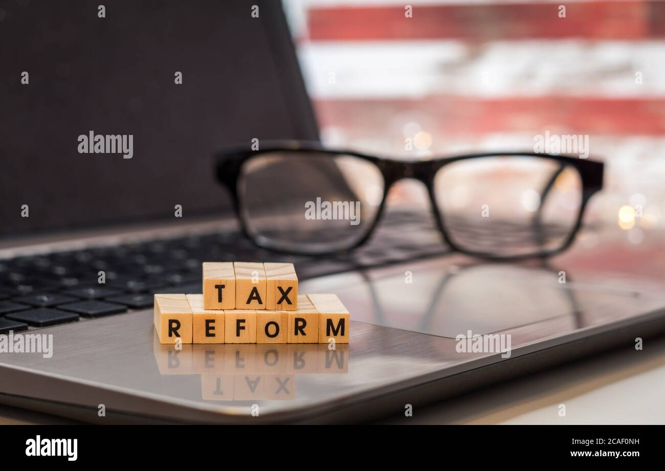 TAX REFORM  letter blocks business finance concept on laptop keyboard Stock Photo