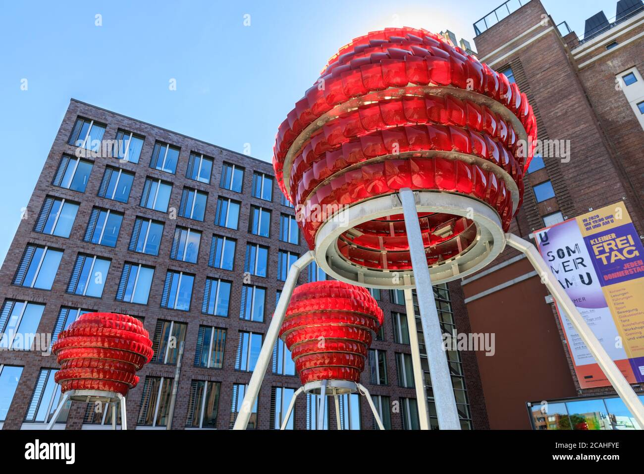 'Dortmunder Rosen' vibrant red public art installation made from recycled car lights by Winter / Hoerbelt, outside Dortmunder U museum, Germany Stock Photo