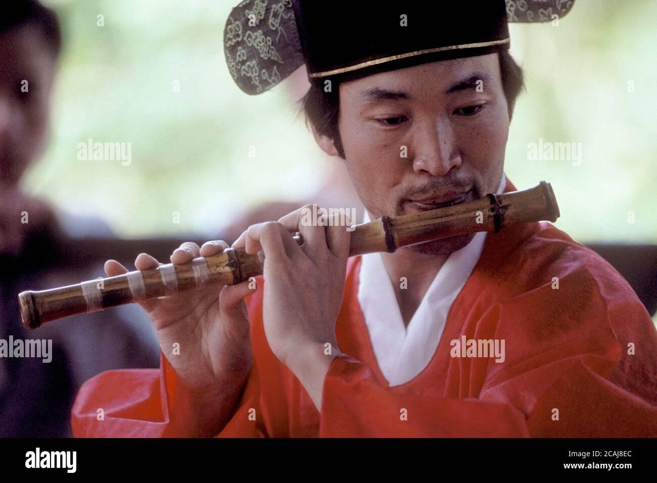 Man In Traditional Korean Dress Playing Wooden Flute At Korean Folk Village Bob Daemmrich Stock Photo Alamy