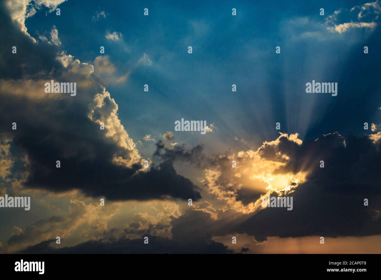 Beams of sunlight coming through storm clouds in Nicosia, Cyprus Stock Photo