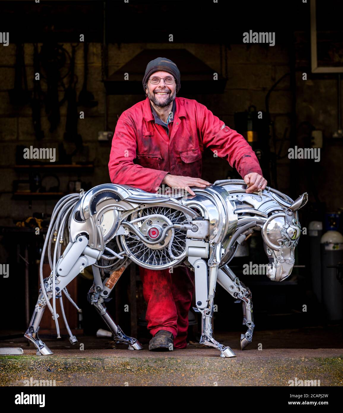 Artist Ptolemy Elrington at his Portslade studio in East Sussex UK where he create sculptures made from car hub caps and other reclaimed car parts. Stock Photo