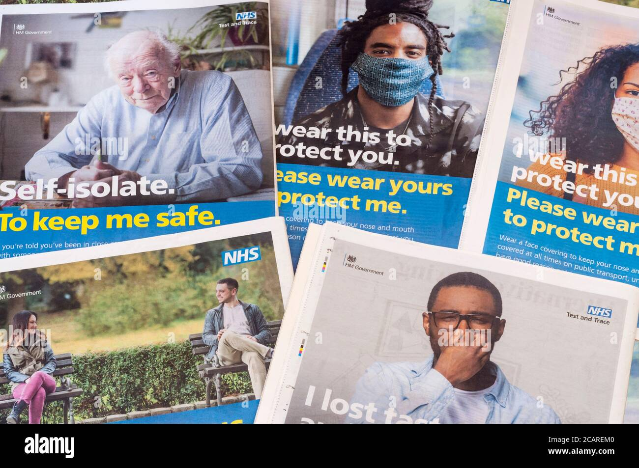 A selection of UK government NHS advertisements promoting a variety of coronavirus COVID-19 safety precautions during the 2020 pandemic. Stock Photo