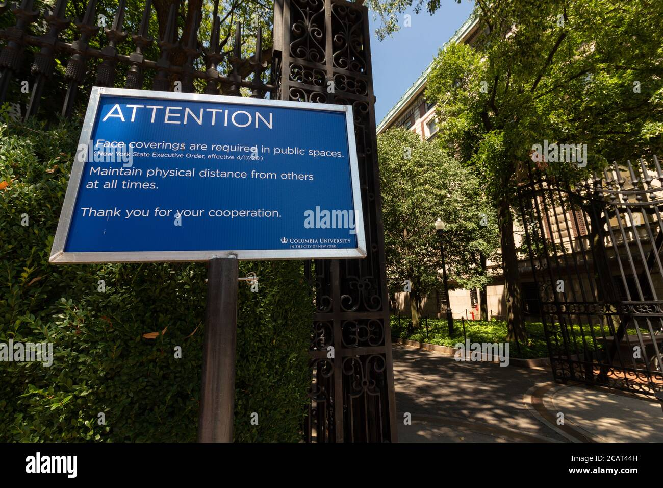 sign at the Columbia University campus stating that face coverings and social distancing are required due to the coronavirus or covid-19 pandemic Stock Photo
