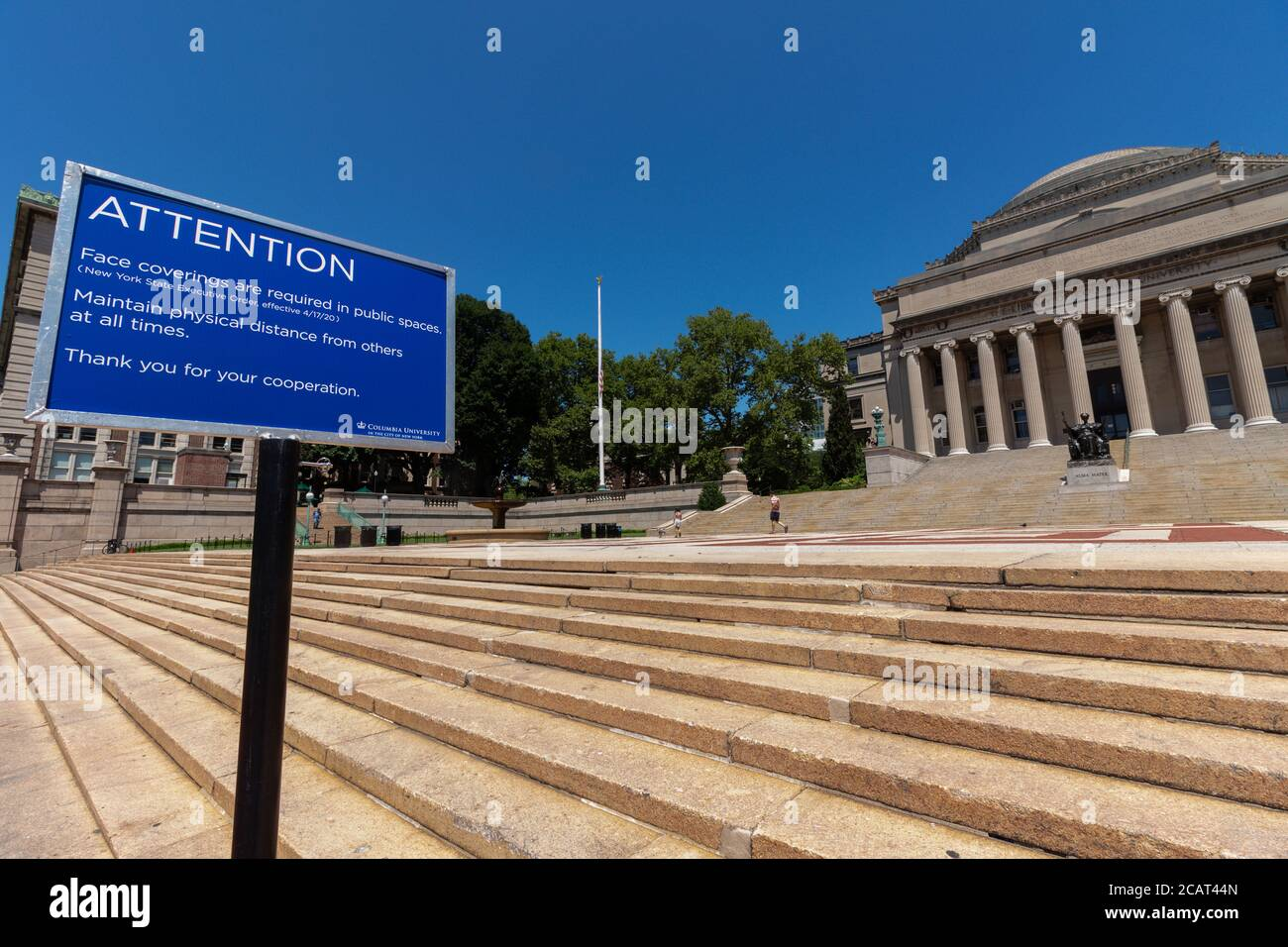 sign near the Columbia University Library stating that face coverings and social distancing are required due to the coronavirus or covid-19 pandemic Stock Photo