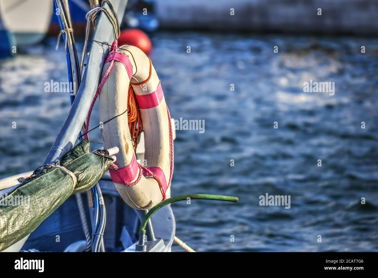 closeup of a life buoy on a wooden boat Stock Photo