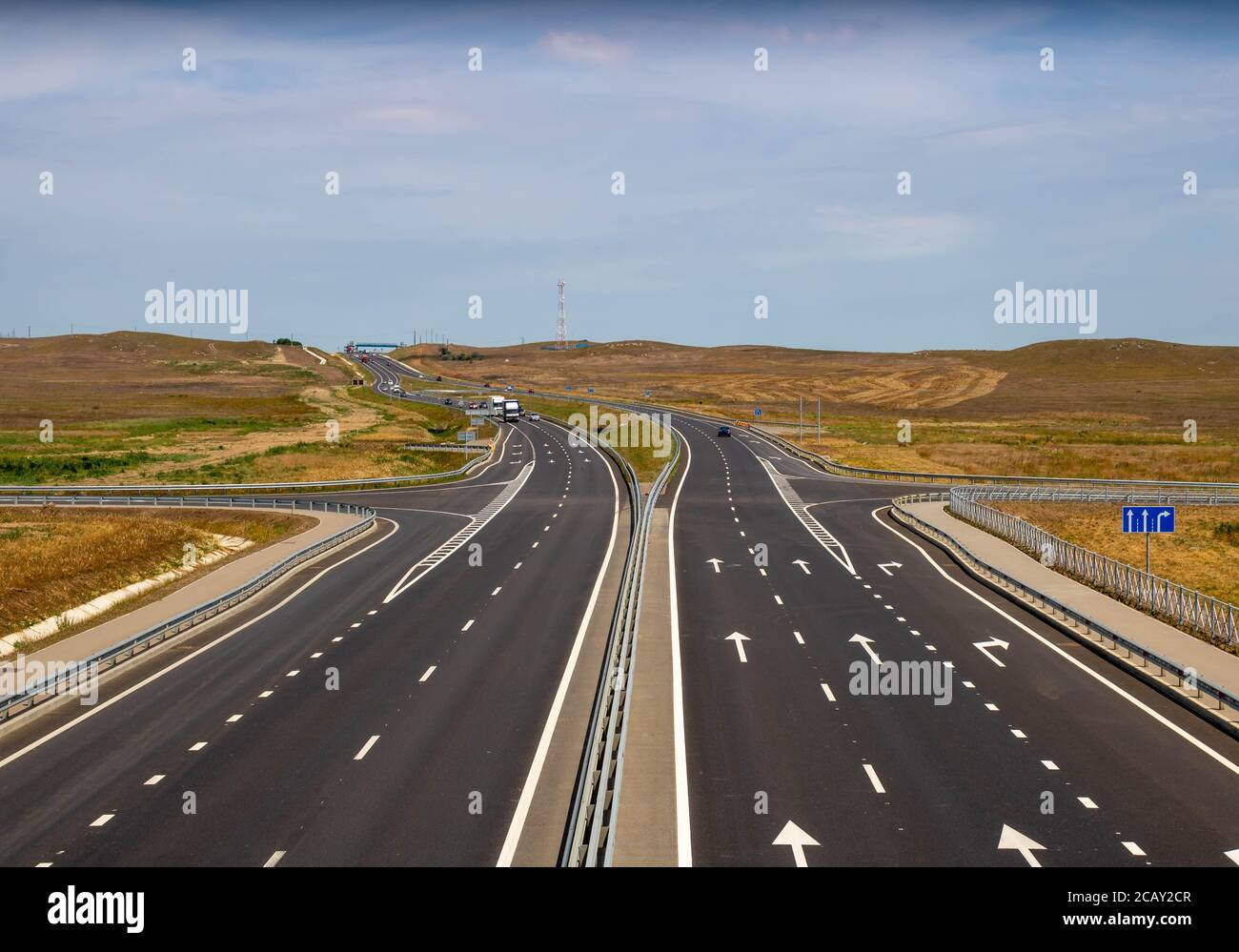 highway in steppe against a blue sky,long road stretching out into the distance Stock Photo