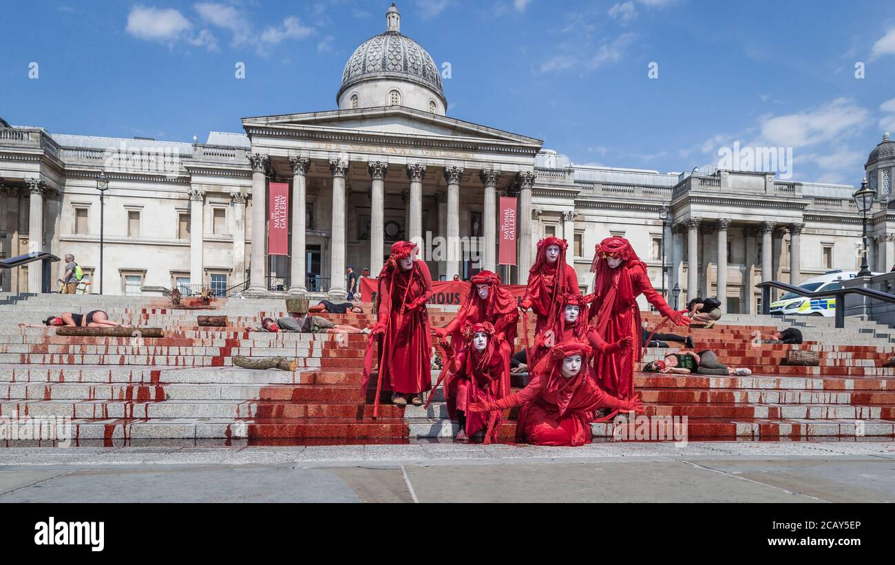 Red Rebels of Extinction Rebellion join the marking International Day of the World's Indigenous Peoples protest in Trafalgar Square, London Stock Photo