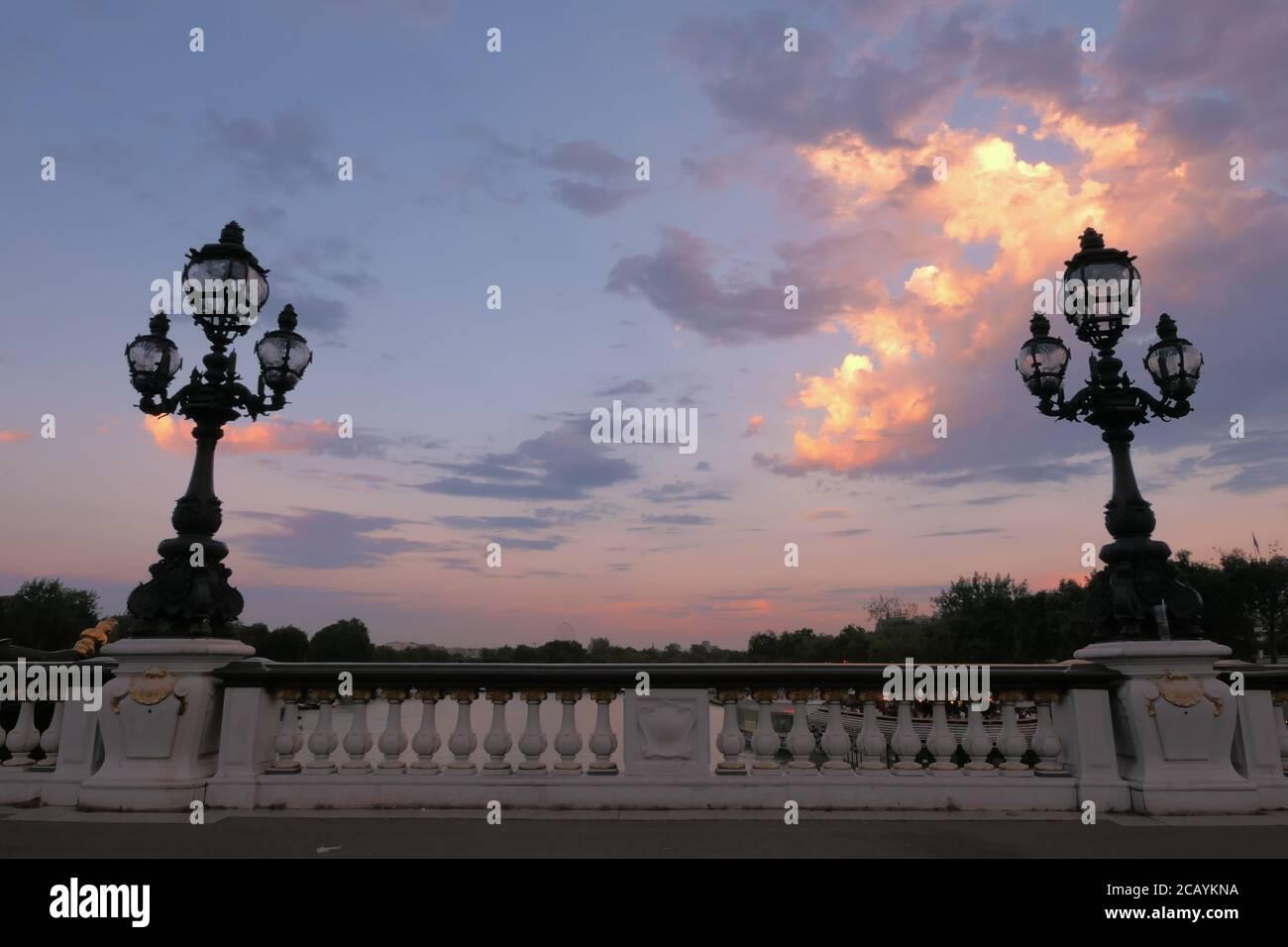 Paris, France. August 08. 2020. Sunset on the famous Alexander 3 Bridge. Historic retro-style lampposts. Very touristy place. Stock Photo