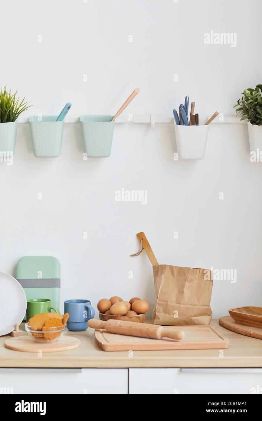 Vertical Background Image Of Minimal Kitchen Interior With Baking Utensils In Small And Cozy Apartment Copy Space Stock Photo Alamy