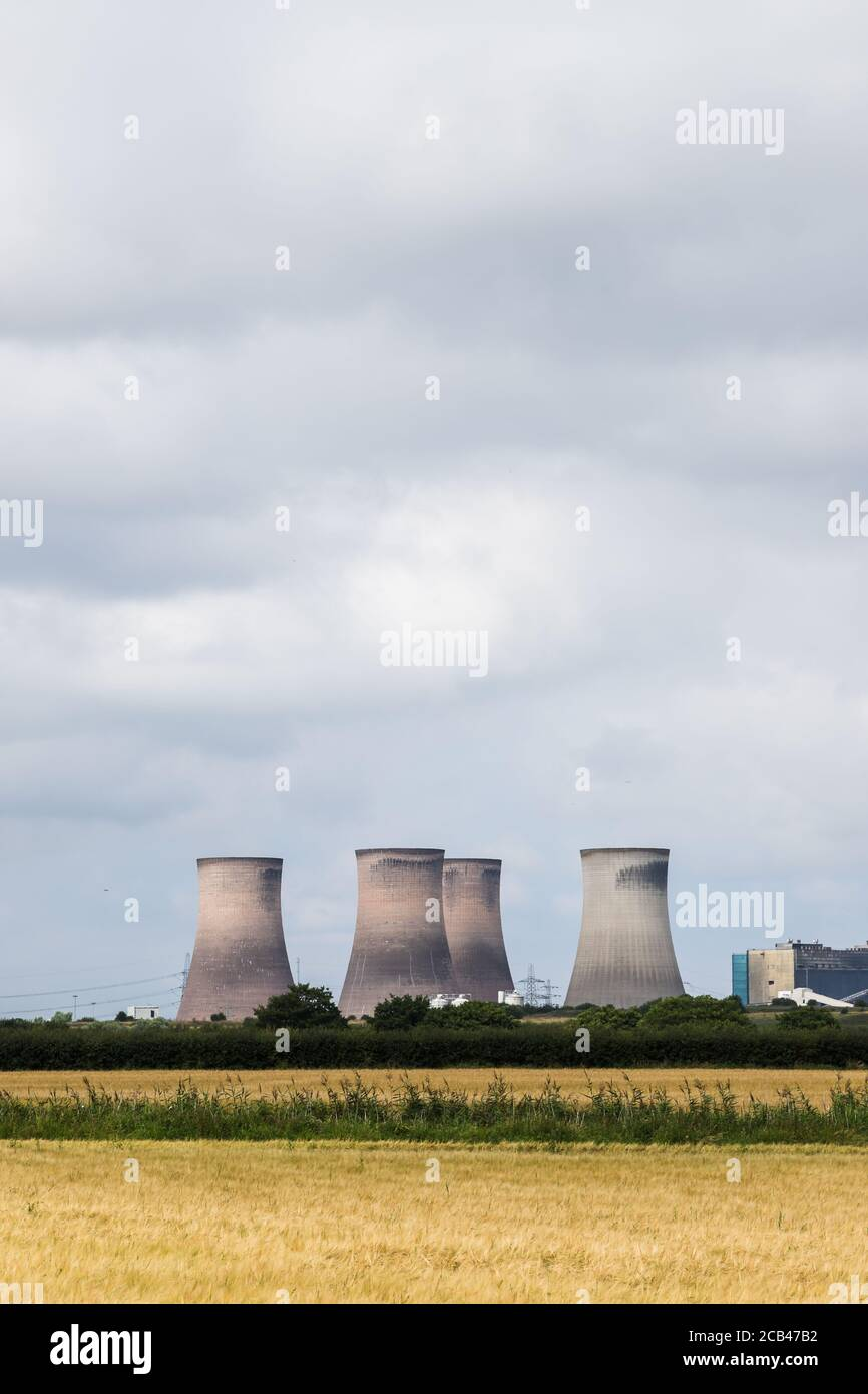 Fiddlers Ferry power station behind a field of wheat in Cheshire, England seen in August 2020. Stock Photo