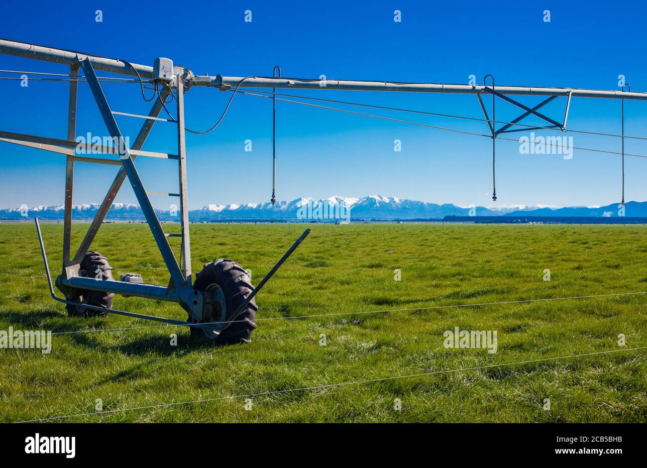 New Zealand Countryside Scenes: Irrigation Infrastructure: Centre-pivot Irrigator watering a circular or semi-circular paddock. Stock Photo