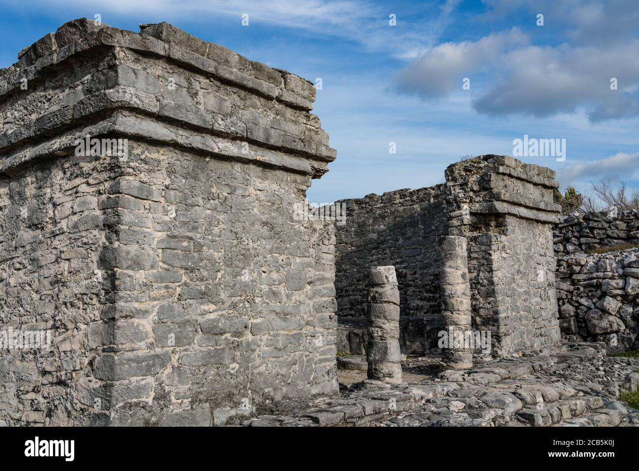 The House of the Cenote in the ruins of the Mayan city of Tulum on the coast of the Caribbean Sea.    Tulum National Park, Quintana Roo, Mexico.  It i Stock Photo
