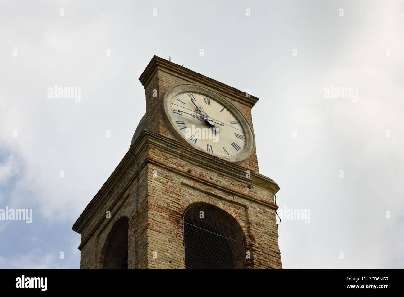 A medieval bell and clock tower of an ancient church (Pesaro, Italy, Europe) Stock Photo