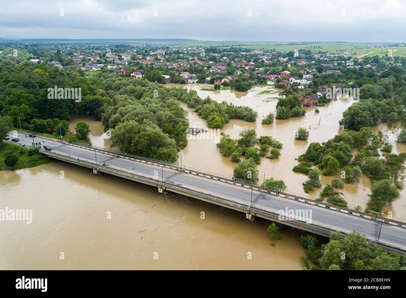 Aerial view of flooded houses with dirty water of Dnister river in Halych town, western Ukraine. Stock Photo