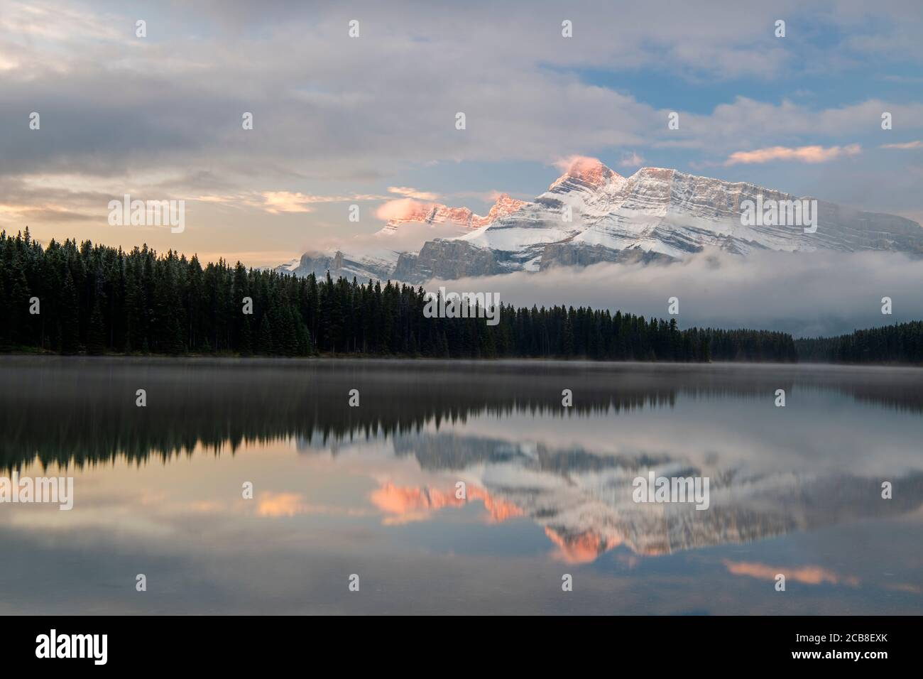 Mt. Rundle reflected in Two Jack Lake at dawn, Banff National Park, Alberta, Canada Stock Photo