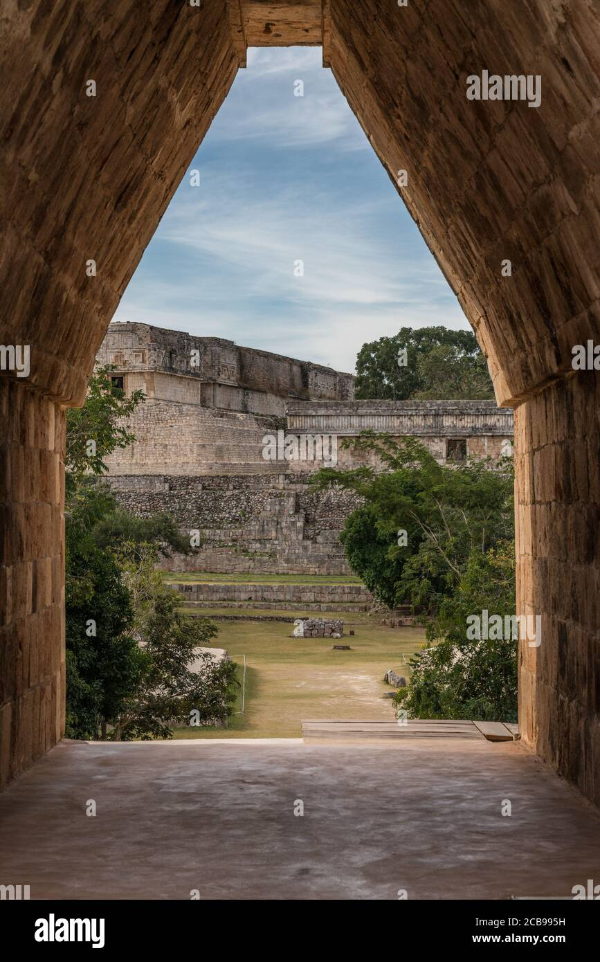 The main entrance into the Nunnery Quadrangle is through a corbel arch doorway in the center of the south building in the pre-Hispanic Mayan ruins of Stock Photo