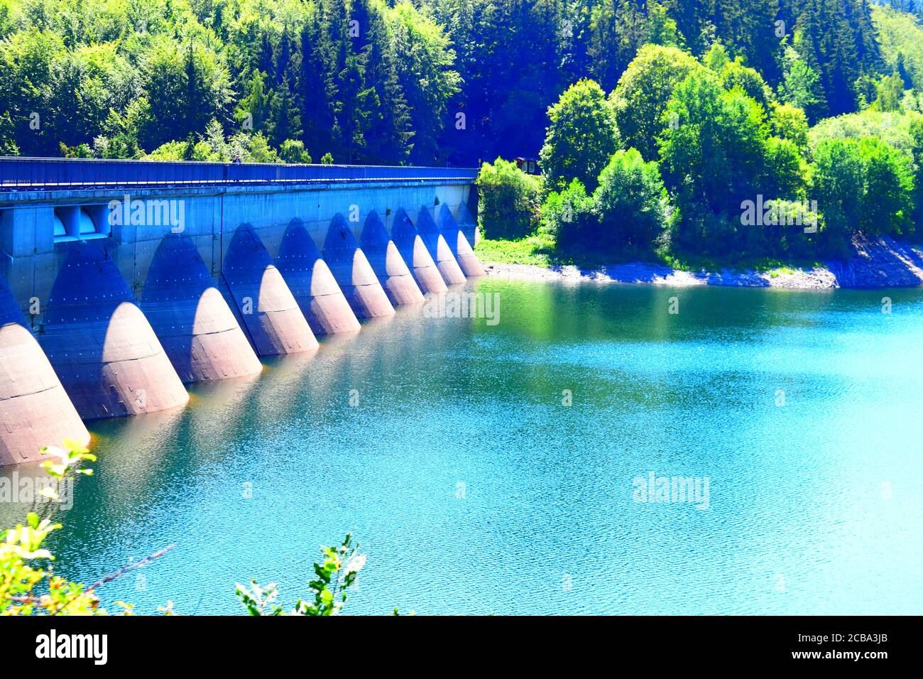lakeside of the dam wall of Oleftalsperre with the water height scale Stock Photo