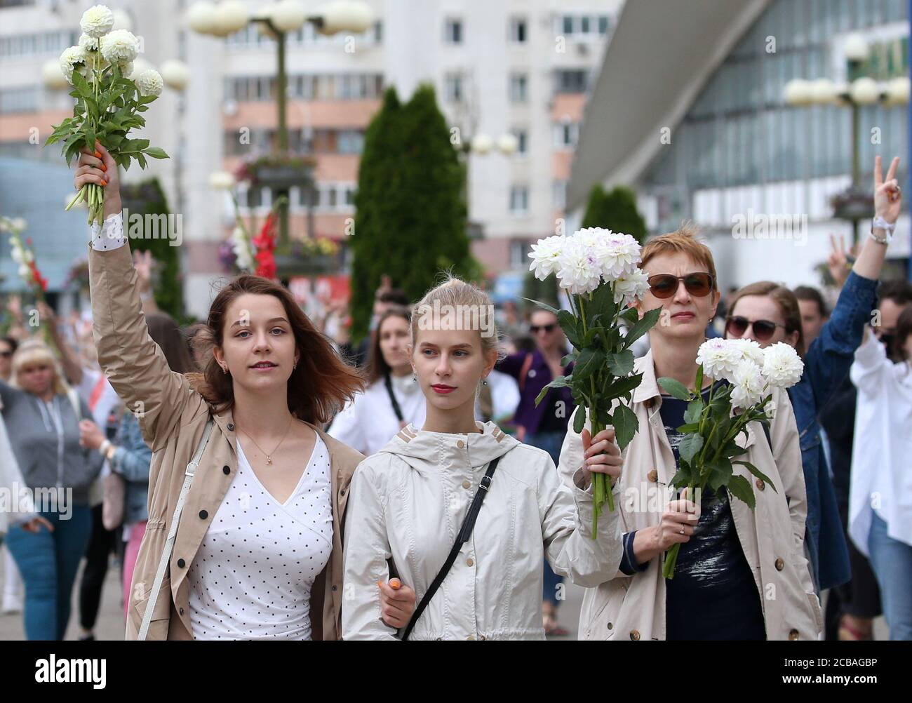 Minsk, Belarus. 12th Aug, 2020. Women take part in an event in support of detained and injured participants in mass protests. Mass protests against the results of the 2020 Belarusian presidential election erupted in major cities across Belarus in the evening of August 9. Credit: Natalia Fedosenko/TASS/Alamy Live News Stock Photo