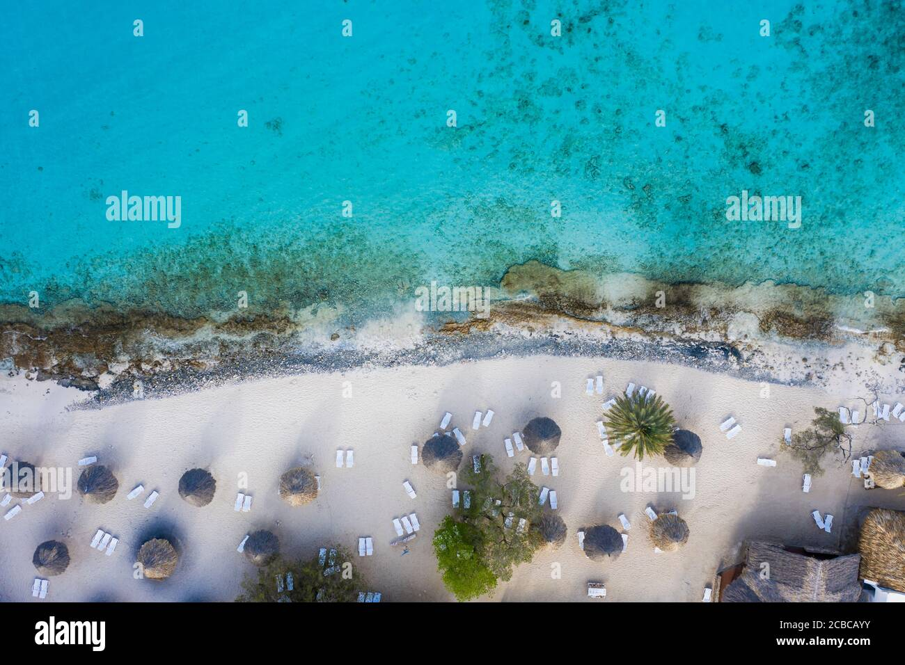 Aerial view of coast of Curaçao in the Caribbean Sea with turquoise water, cliff, beach and beautiful coral reef Stock Photo