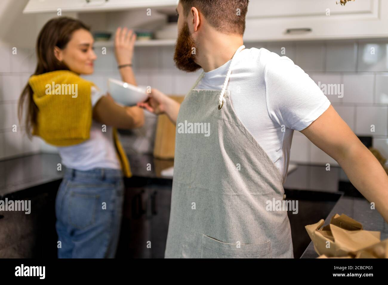young caucasian married couple are moving to another apartment, they happily unpack boxes together. happy family, house concept Stock Photo