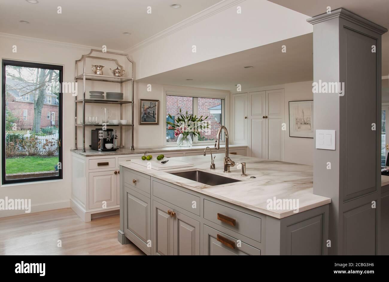 Gray And White Kitchen With Marble Backsplash Stock Photo Alamy