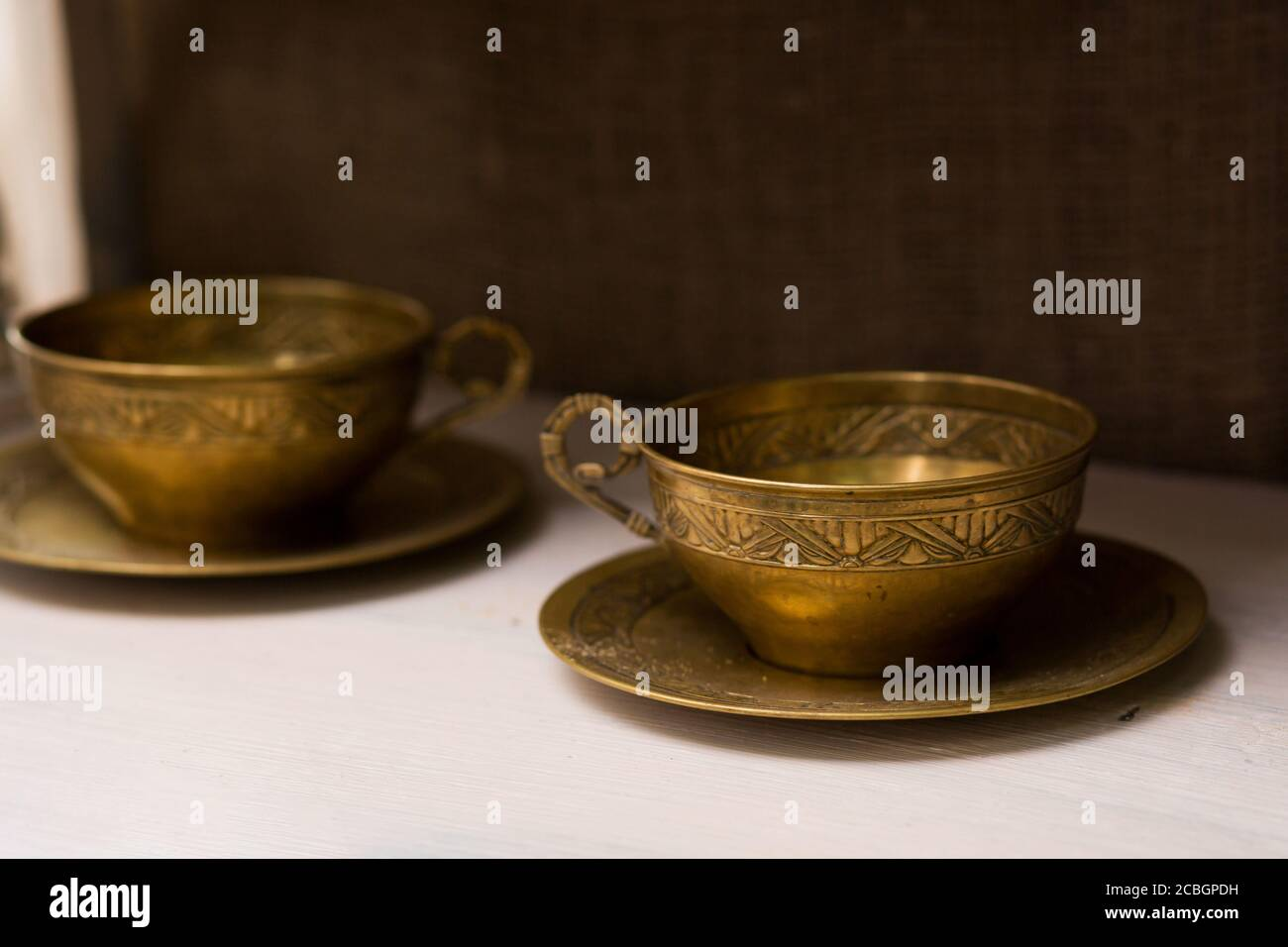 Antique Tea Mugs With Copper Saucers Unusual Home Decor Items Stock Photo Alamy