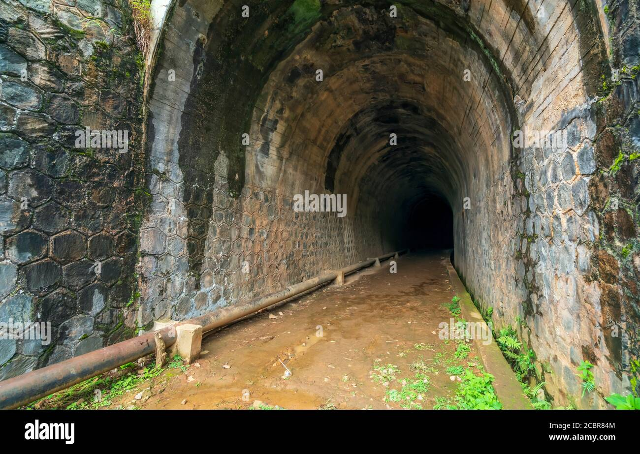 Abandoned Railway Tunnel in the plateau, French architecture built in the 19th century and exists today near Dalat, Vietnam. Stock Photo