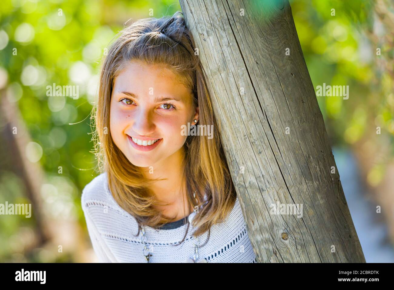 Teengirl portrait smiling at camera eyeshot Stock Photo