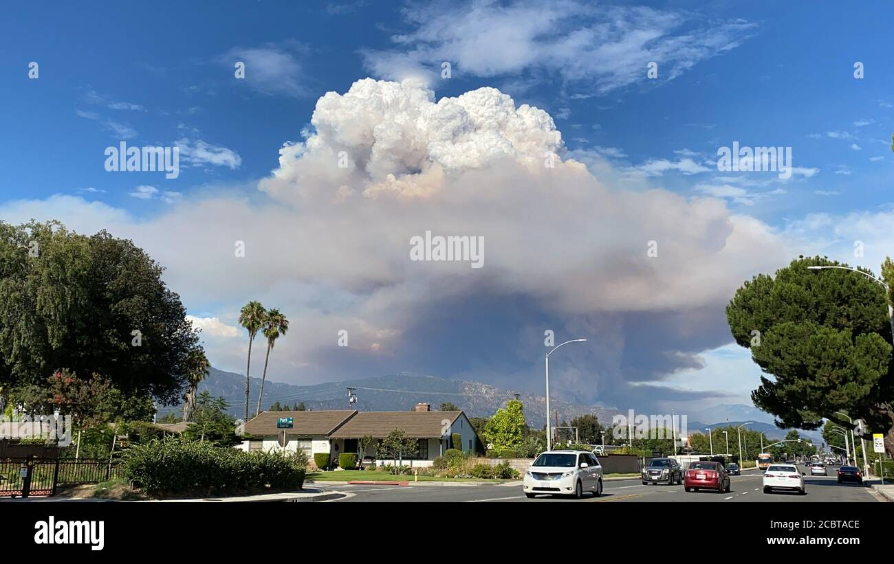 Los Angeles, USA. 13th Aug, 2020. Photo taken on Aug. 13, 2020 shows the dust cloud from the so-called Ranch 2 Fire in Los Angeles County, the United States. Smoke from several wildfires burning in Southern California has caused unhealthy air quality, authorities said on Aug. 15. The so-called Ranch 2 Fire, burning in the Angeles National Forest north of Azusa, has scorched 1,400 acres (around 5.66 square kilometers) and was only 3 percent contained as of Saturday morning. The fire was first reported Thursday afternoon. Credit: Gao Shan/Xinhua/Alamy Live News Stock Photo
