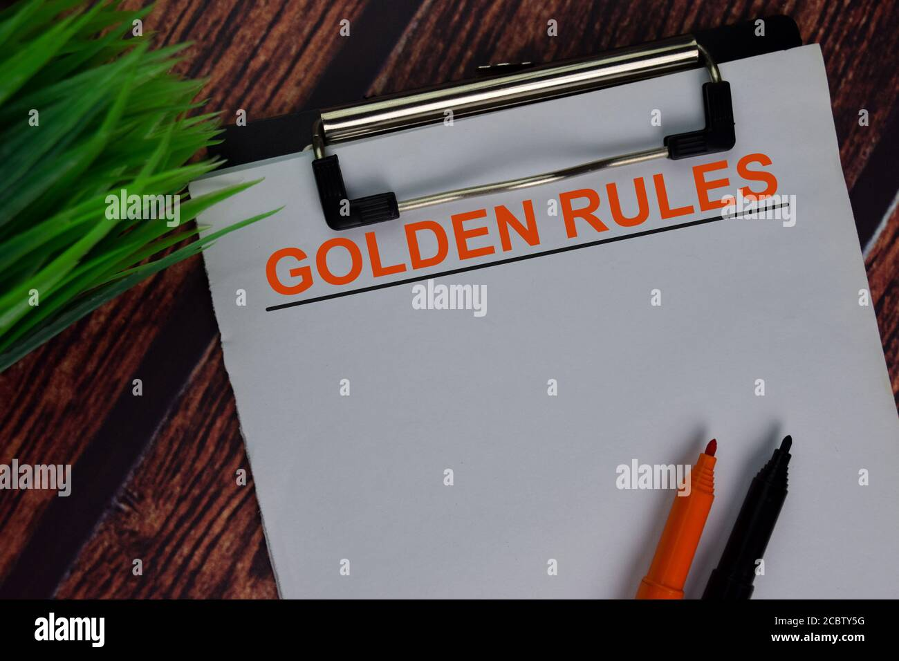 Golden Rules text write on a paperwork isolated on office desk. Stock Photo